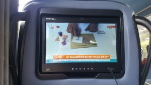 Many buses are equipped with personal multimedia centers, mounted in the back of the seats in front
