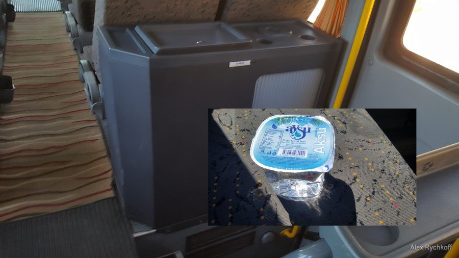 Fridge with water in the bus