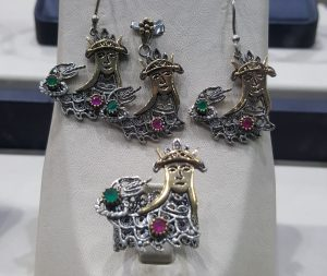 Image of Shahmaran on the silver jewelry from Mardin.
