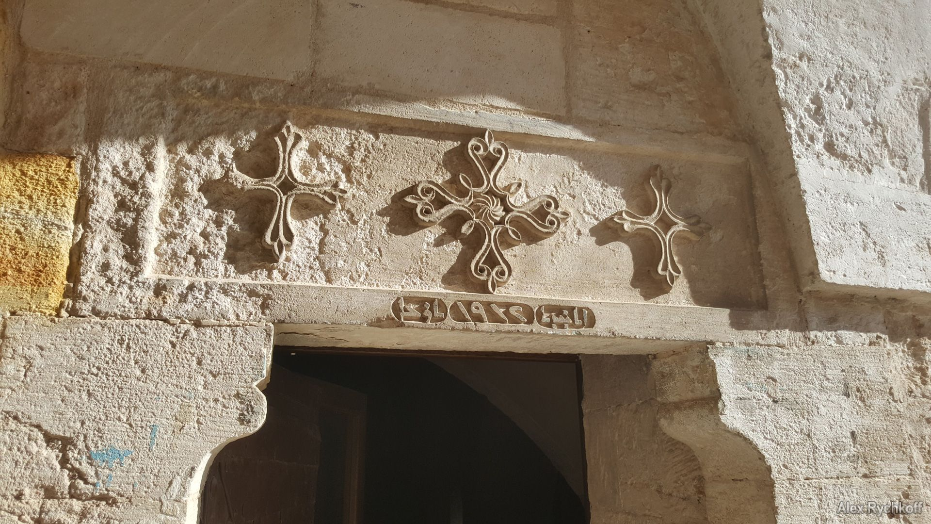 Crosses carved in stone above the entrance to the church